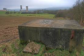 Concrete water tank in a field